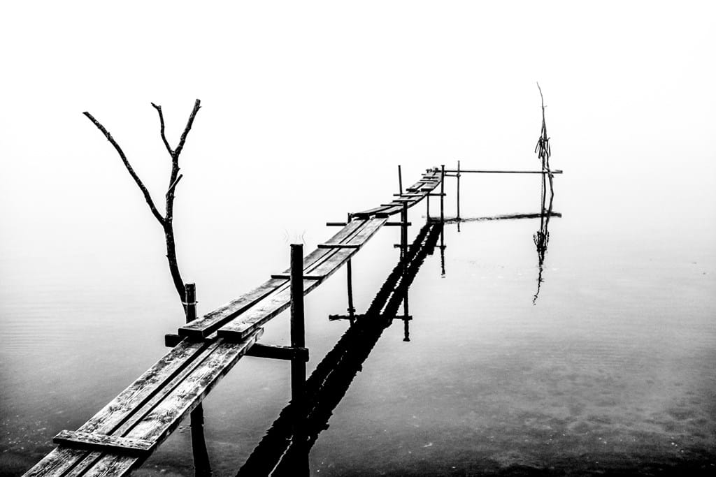 Poster: Mist in Morga hage - A pier in a little lake that has a minimalistic feeling that makes is so ea...