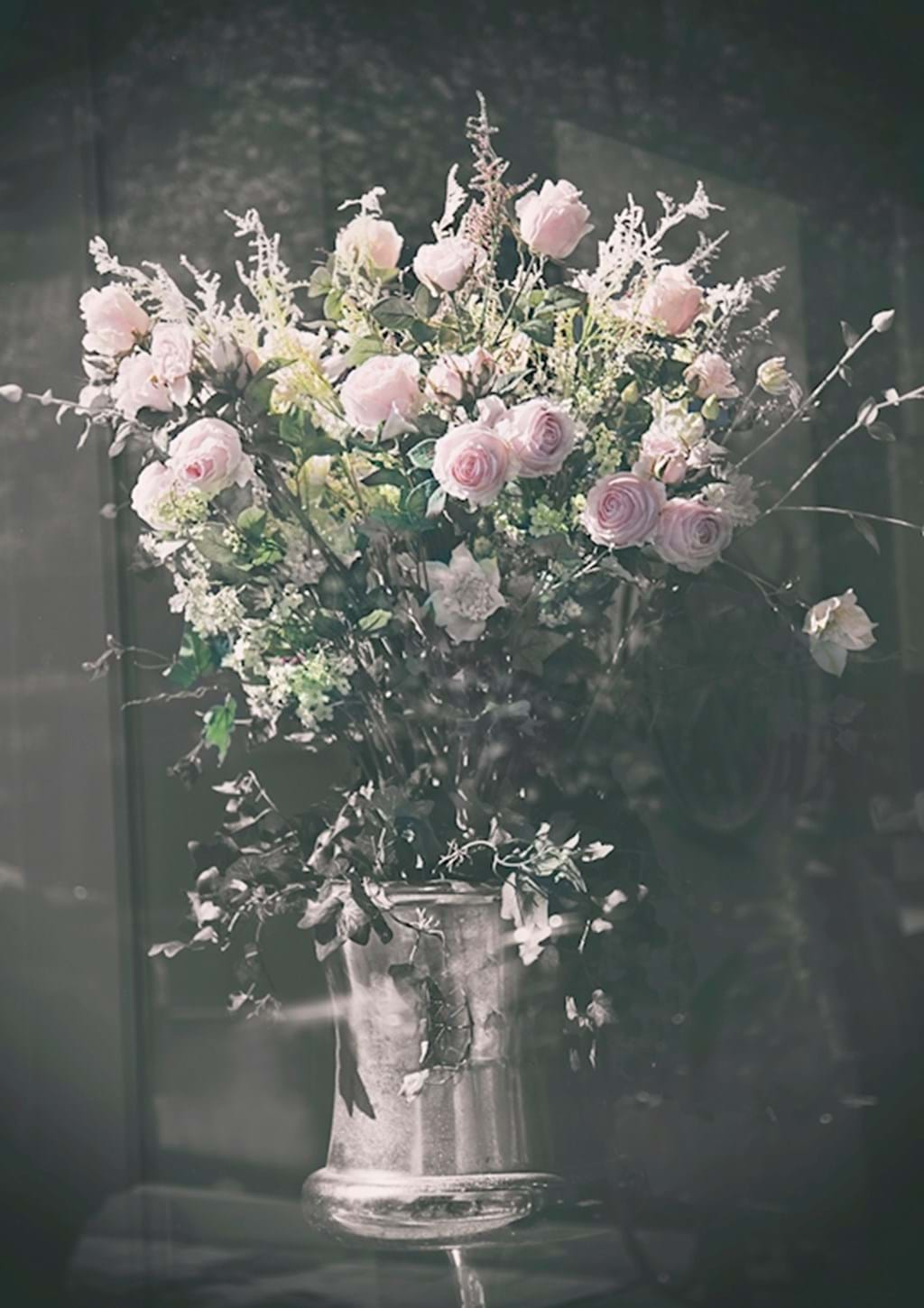 Poster: The bouquet in the window - This beautiful picture was taken on a normal day in Stockholm. It is very a...