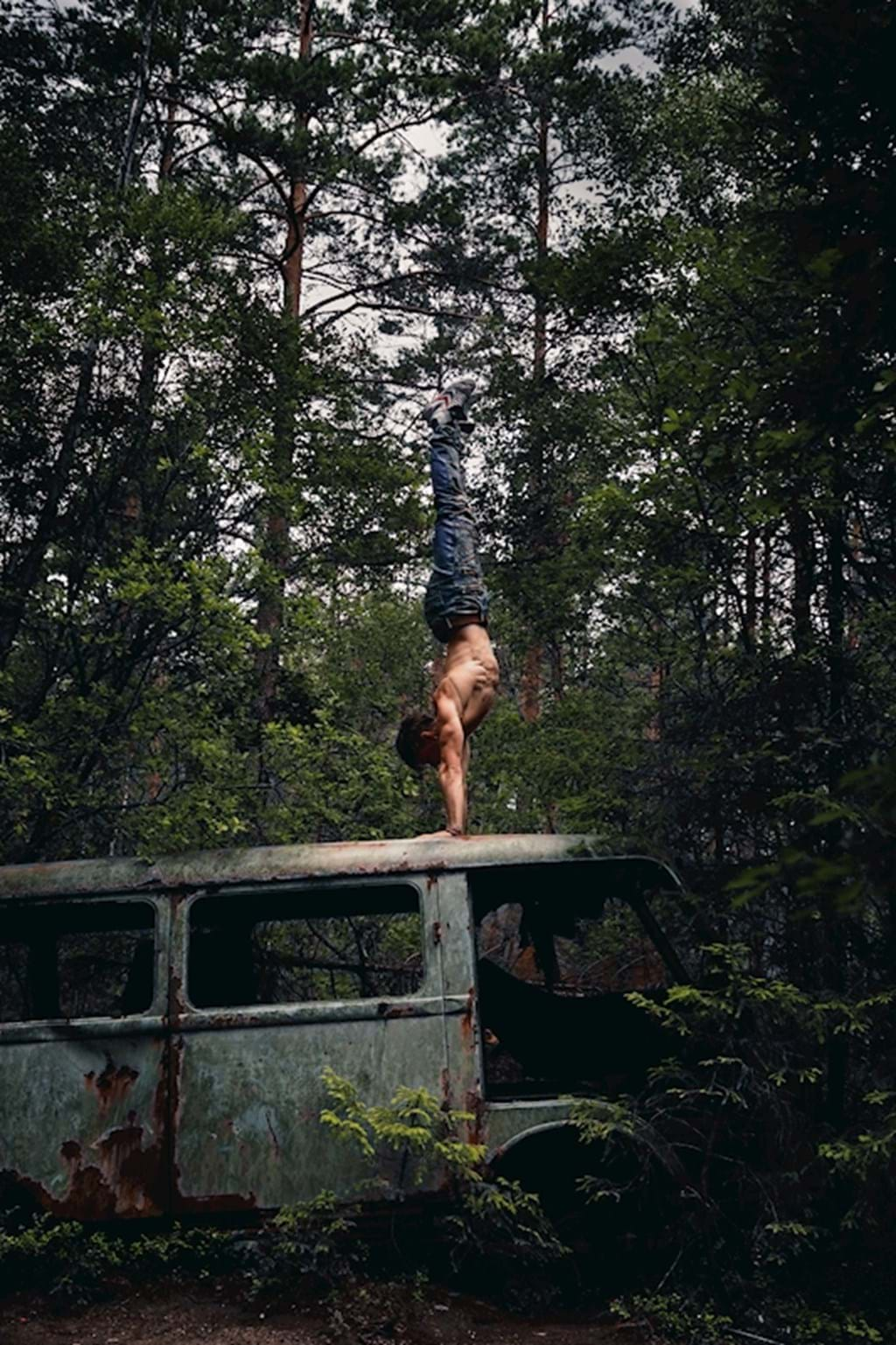 Poster: Forest handstand on a bus - People