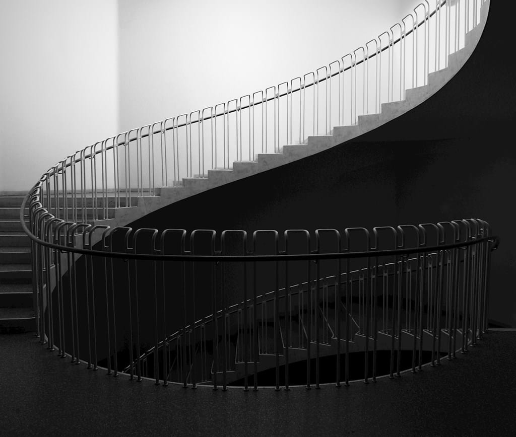 Poster: The staircase - A black and white print of a simple yet intriguing spiral staircase leading...