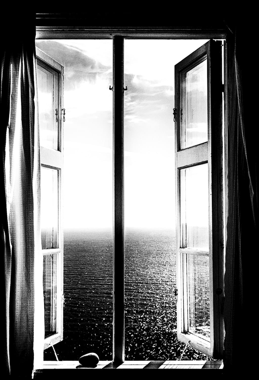Poster: The view from the lighthoouse - This black and white photograph of an open window overlooking the ocean is ...