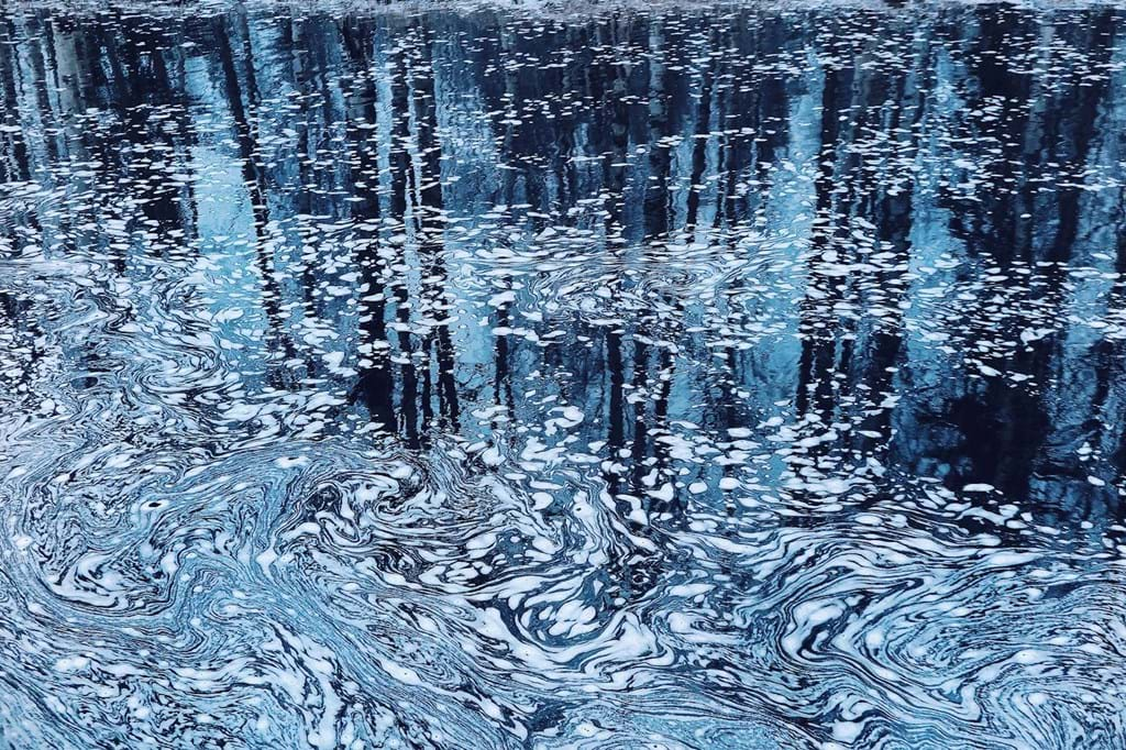 Poster: Monet was here - A wonderful picture of the water surface with foam making a pattern. The co...